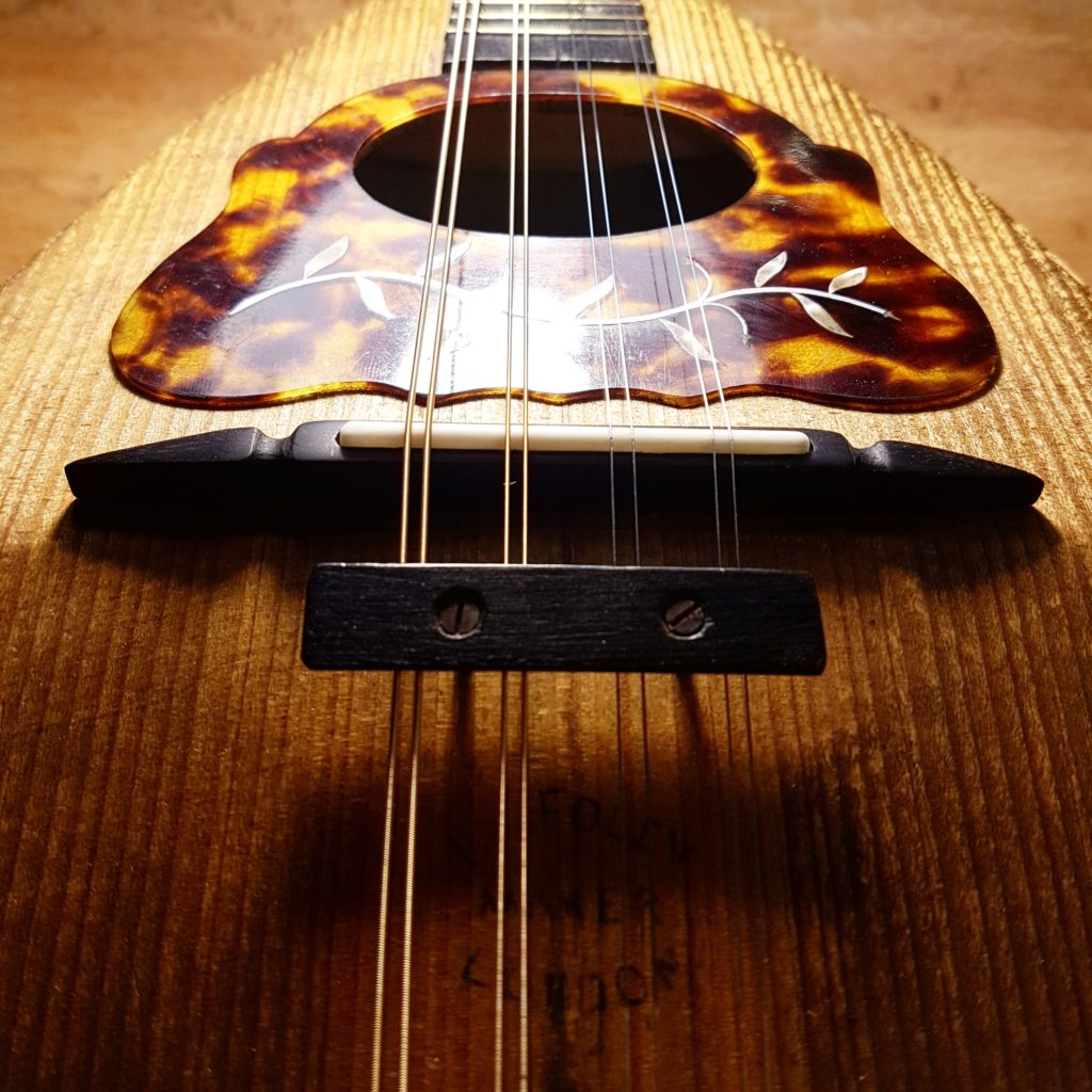 This lovely old mandolin was missing its bridge which we carved to match the one it would have originally had