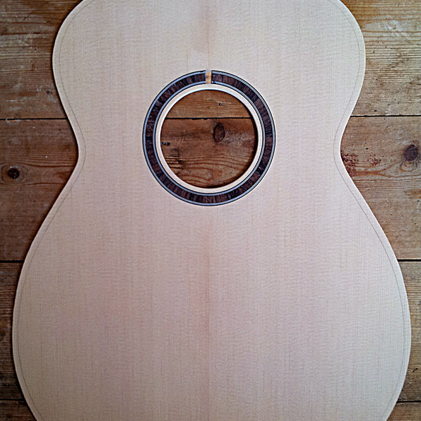 The sitka spruce front for an OM guitar is ready for bracing