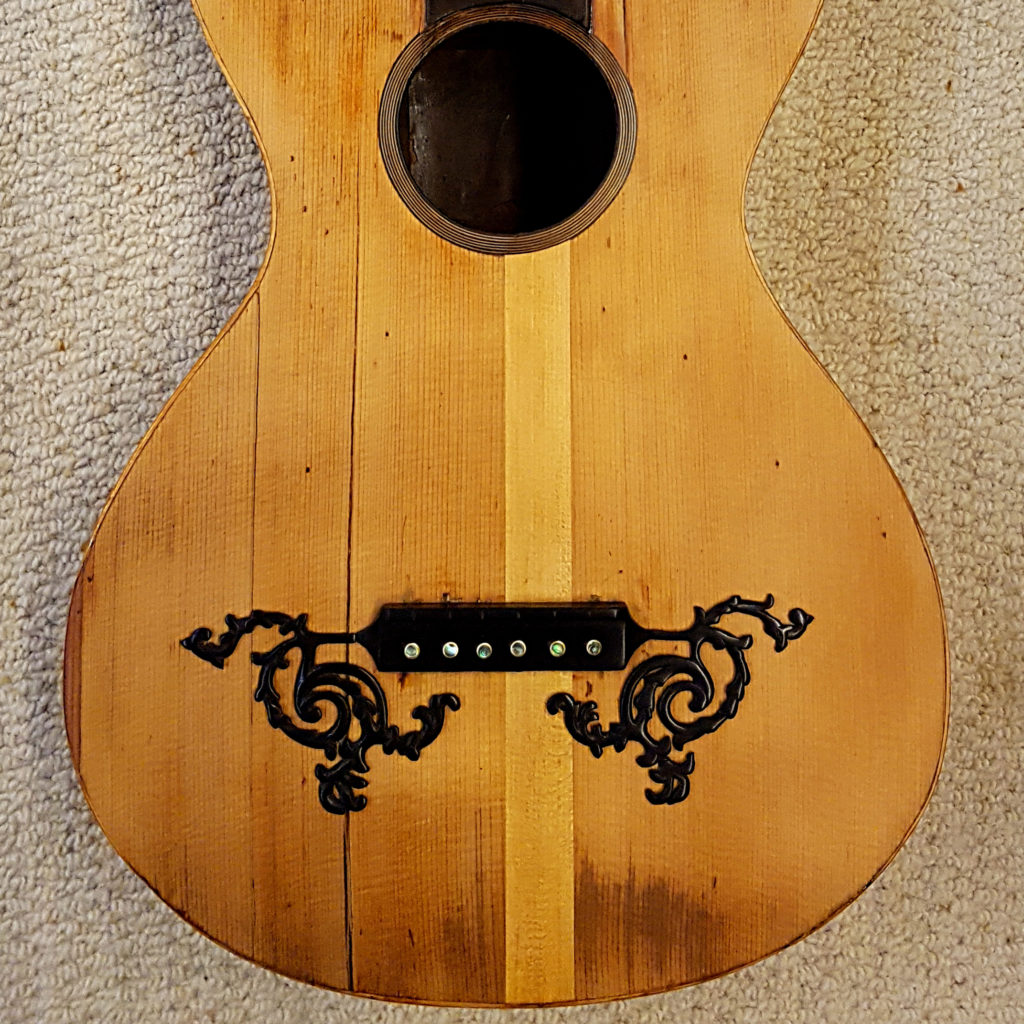 This little parlour guitar had been repaired previously but was still missing the ornamentation which we carved from ebony