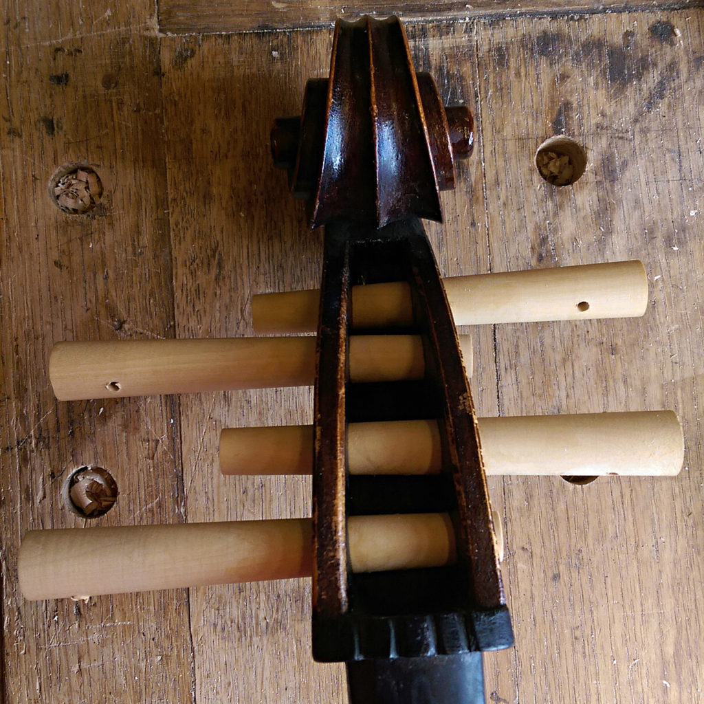 Peg bushings are very typical for many older instruments