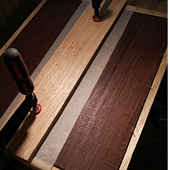 The back joint of a lovely piece of rosewood under clamps after glueing