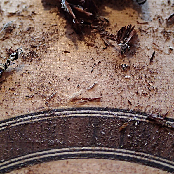 Cutting back the rosewood rosette using a scraper