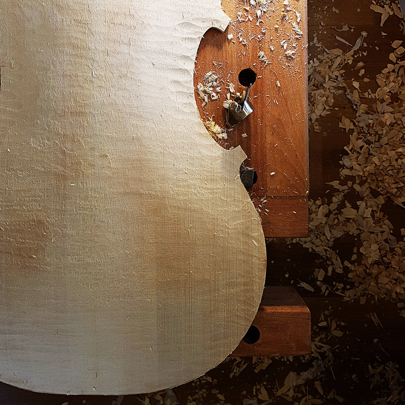 After using the gouge the thumb planes start to fine tune the arch shape