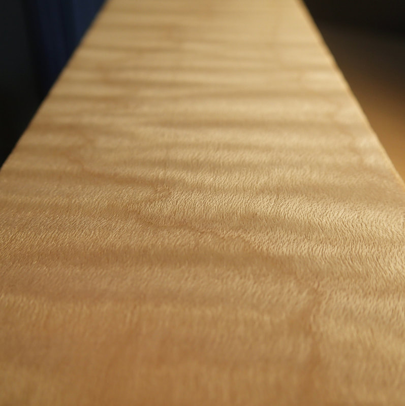 Close up the grain in amazing of this highly flamed curly maple cello back